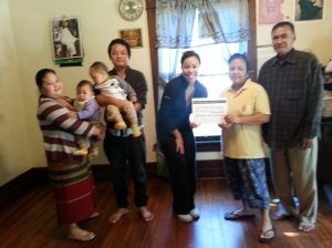 Burmese family signs the CV Welcome Pledge!