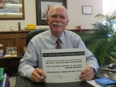 Waterloo Mayor Buck Clark is happily signs the CV Welcome Pledge!